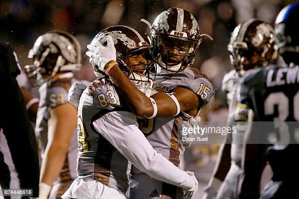 Michael Henry and Carrington Thompson of the Western Michigan Broncos celebrate after scoring a touchdown in the third quarter against the Buffalo...