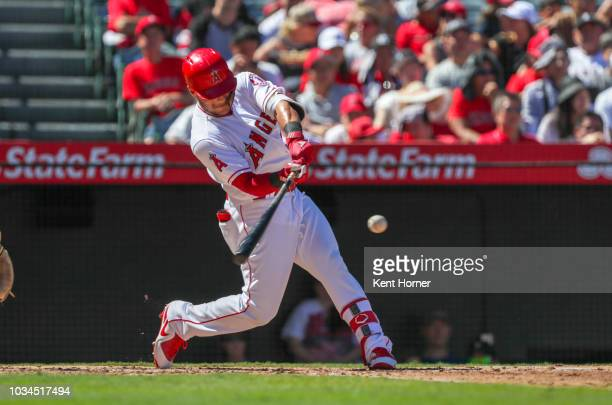 Michael Hermosillo of the Los Angeles Angels hits the balll in the 3rd inning against the Seattle Mariners at Angel Stadium on September 16 2018 in...