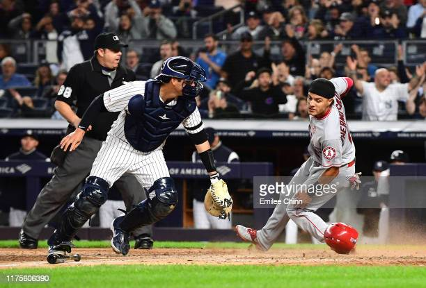 Michael Hermosillo of the Los Angeles Angels slides safely into home base during the sixth inning of their game against the New York Yankees at...