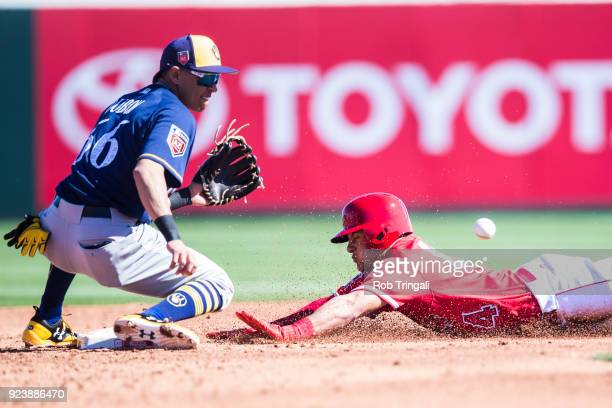 Michael Hermosillo of the Los Angeles Angels steals second base as Mauricio Dubon of the Milwaukee Brewers awaits for the ball during a Spring...