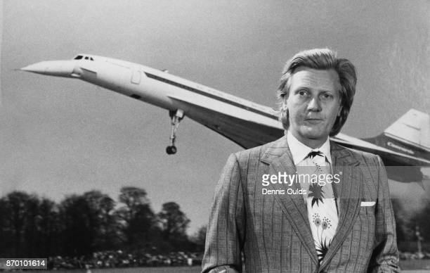 Michael Heseltine the Minister of State for Aerospace and Shipping in front of a photograph of the supersonic airliner Concorde 5th July 1972