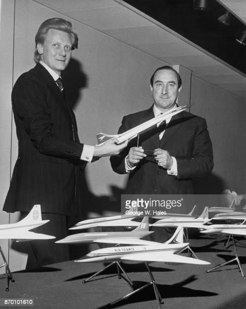 Michael Heseltine the Minister of State for Aerospace and Shipping and test pilot Brian Trubshaw inspect models of the supersonic airliner Concorde...