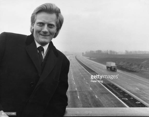 Michael Heseltine the Parliamentary Secretary of State to the Department of the Environment on a bridge over the new M4 motorway at the Badbury...