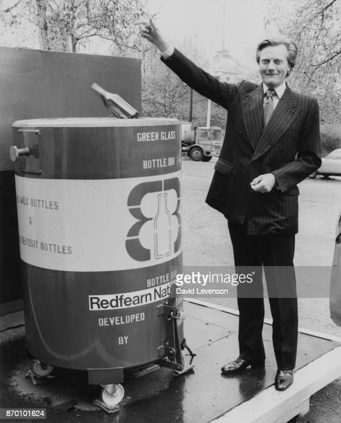 Michael Heseltine the Secretary of State for the Environment tries out a new Bottle Bin a smaller version of the Bottle Bank for recycling glass on...