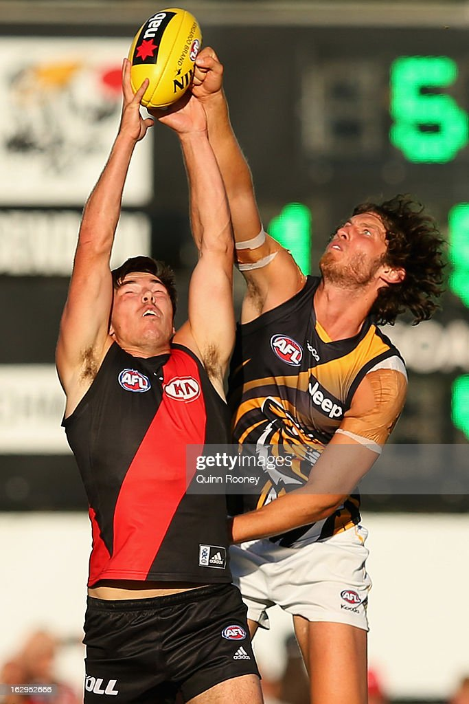 Michael Hibberd of the Bombers marks infront of Tyrone Vickery of the Tigers during the round two AFL NAB Cup match between the Essendon Bombers and the Richmond Tigers at Wangaratta Showgrounds on March 2, 2013 in Wangaratta, Australia.