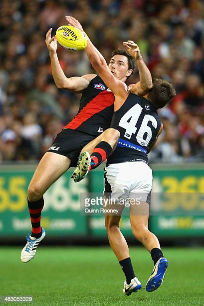 Michael Hibberd of the Bombers marks over the top of David Ellard of the Blues during the round three AFL match between the Essendon Bombers and the...