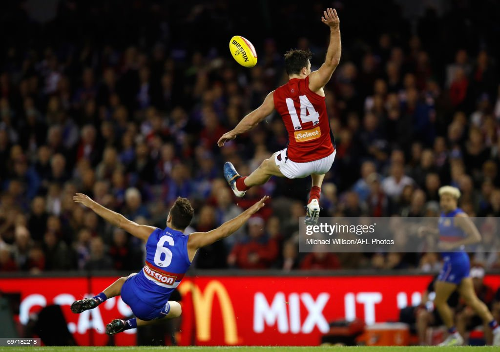 Michael Hibberd of the Demons and Luke Dahlhaus of the Bulldogs compete for the ball during the 2017 AFL round 13 match between the Western Bulldogs and the Melbourne Demons at Etihad Stadium on June 18, 2017 in Melbourne, Australia.