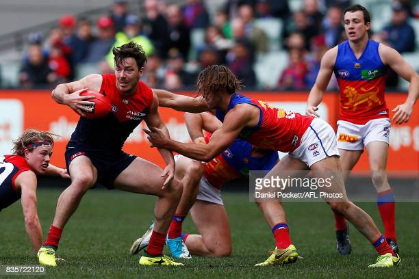 Michael Hibberd of the Demons and Rhys Mathieson of the Lions contest the ball during the round 22 AFL match between the Melbourne Demons and the...