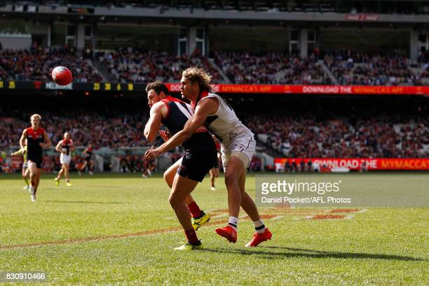 Michael Hibberd of the Demons and Sam Gilbert of the Saints contest the ball during the round 21 AFL match between the Melbourne Demons and the St...