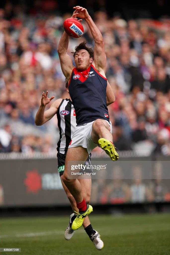 Michael Hibberd of the Demons attempts to mark the ball during the round 23 AFL match between the Collingwood Magpies and the Melbourne Demons at Melbourne Cricket Ground on August 26, 2017 in Melbourne, Australia.