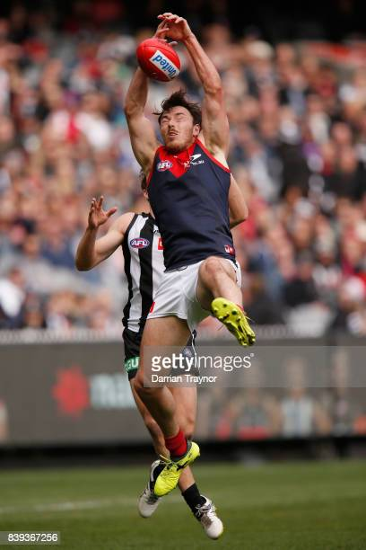 Michael Hibberd of the Demons attempts to mark the ball during the round 23 AFL match between the Collingwood Magpies and the Melbourne Demons at...