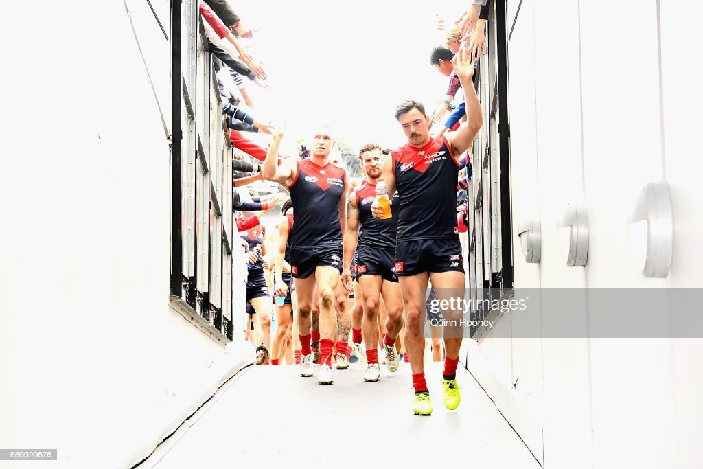 Michael Hibberd of the Demons high fives fans after winning the round 21 AFL match between the Melbourne Demons and the St Kilda Saints at Melbourne Cricket Ground on August 13, 2017 in Melbourne, Australia.
