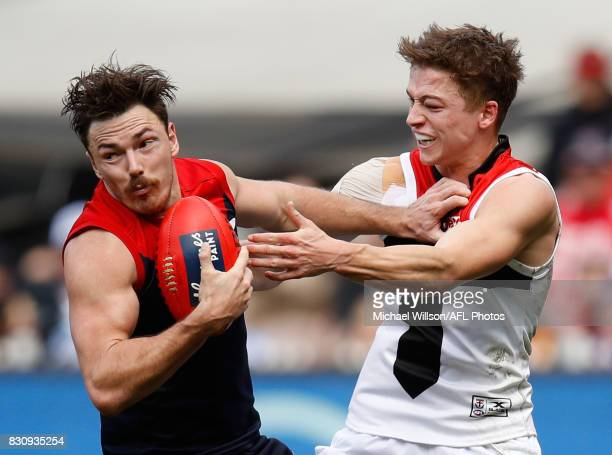 Michael Hibberd of the Demons is tackled by Jack Billings of the Saints during the 2017 AFL round 21 match between the Melbourne Demons and the St...