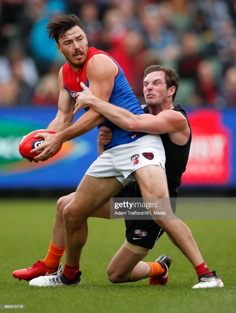 Michael Hibberd of the Demons is tackled by Jed Lamb of the Blues during the 2018 AFL round nine match between the Carlton Blues and the Melbourne Demons at the Melbourne Cricket Ground on May 20, 2018 in Melbourne, Australia.
