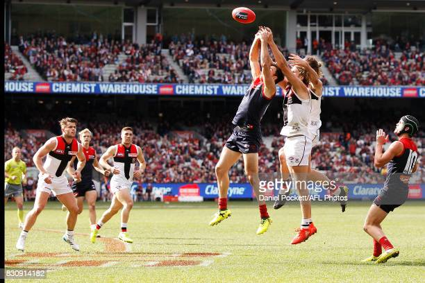 Michael Hibberd of the Demons Josh Bruce of the Saints and Sam Gilbert of the Saints contest the ball during the round 21 AFL match between the...
