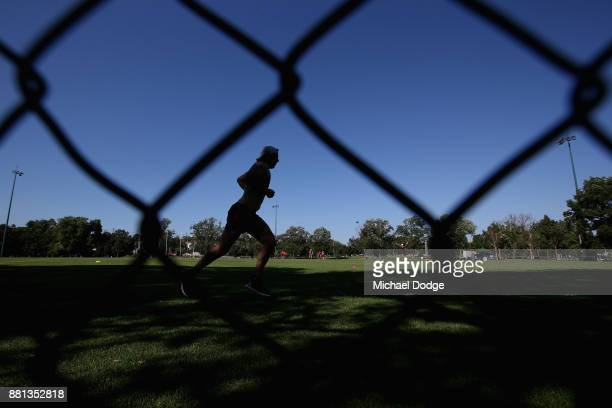 Michael Hibberd of the Demons runs with the ball during a Melbourne Demons AFL training session at Gosch's Paddock on November 29 2017 in Melbourne...