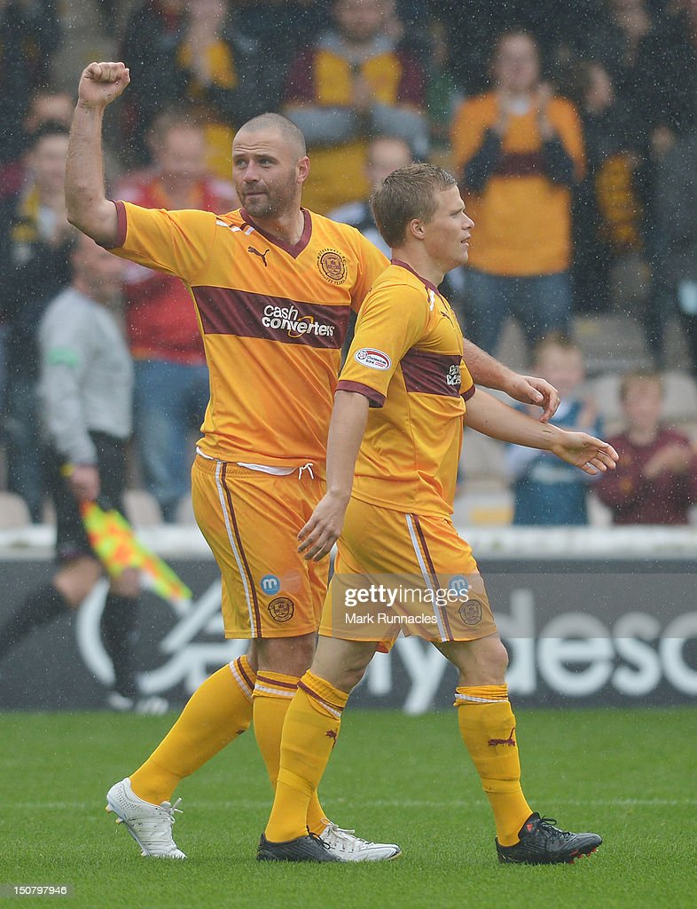 Michael Higdon of Motherwell celebrates his goal with team-mate Henrick Ojamaa against St Mirren during the Clydesdale Bank Scottish Premier League match between Motherwell and St Mirren at Fir Park on August 26, 2012 in Motherwell, Scotland.