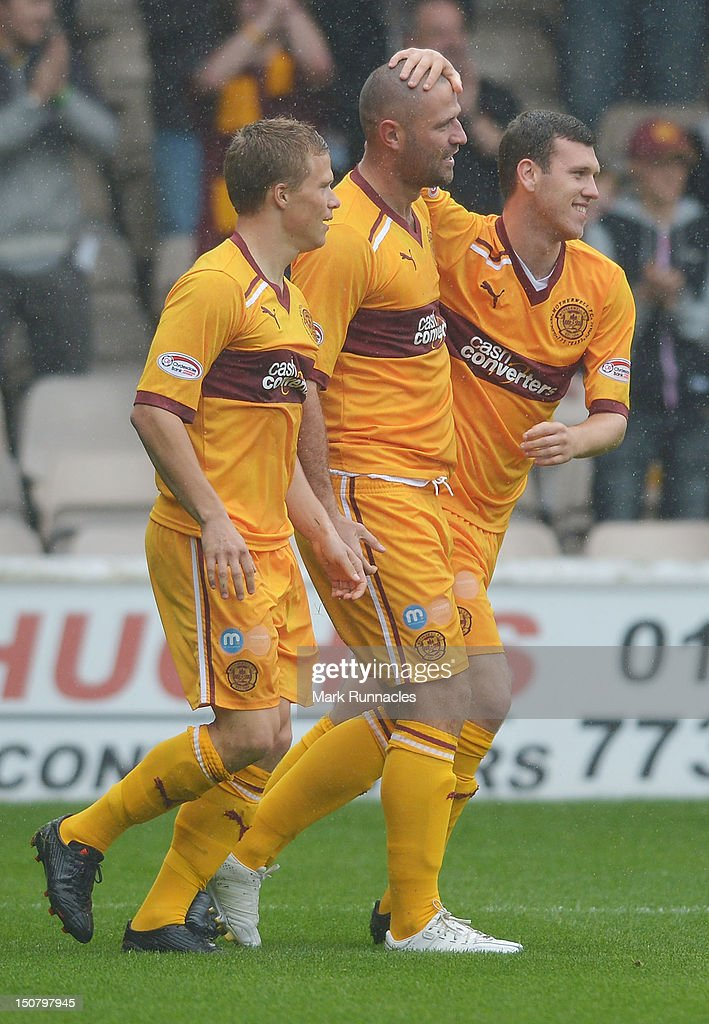 Michael Higdon of Motherwell celebrates his goal with team-mates Henrick Ojamaa and Adam Cummins during the Clydesdale Bank Scottish Premier League match between Motherwell and St Mirren at Fir Park on August 26, 2012 in Motherwell, Scotland.