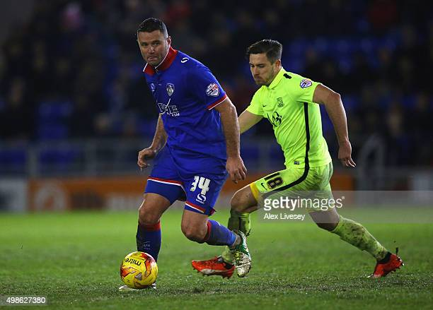 Michael Higdon of Oldham Athletic turns from Ryan Leonard of Southend United during the Sky Bet League One match between Oldham Athletic and Southend...
