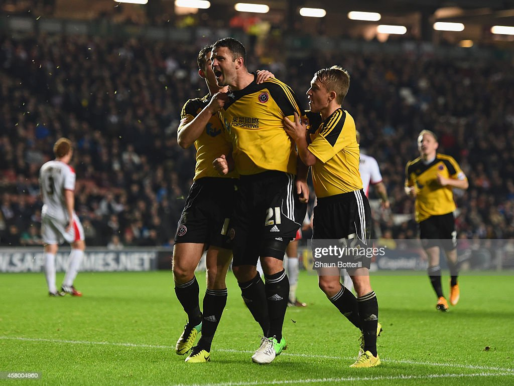 Michael Higdon of Sheffield United celebrates with team-mates Louis Reed and Harrison McGahey after scoring the equalising during the Capital One Cup Fourth Round match between MK Dons and Sheffield United at Stadium mk on October 28, 2014 in Milton Keynes, England.