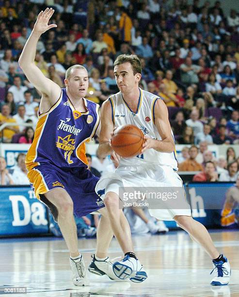 Michael Hill of the Bullets drives to the basket past Bradley Sheridan of the Kings, during NBL match between Sydney Kings and Brisbane Bullets at...