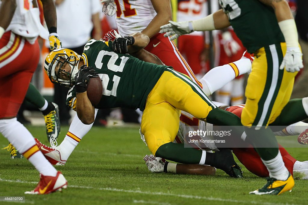 Michael Hill #22 of the Green Bay Packers is taken to the ground in the second half of the preseason game against the Kansas City Chiefs on August 28, 2014 at Lambeau Field in Green Bay, Wisconsin.