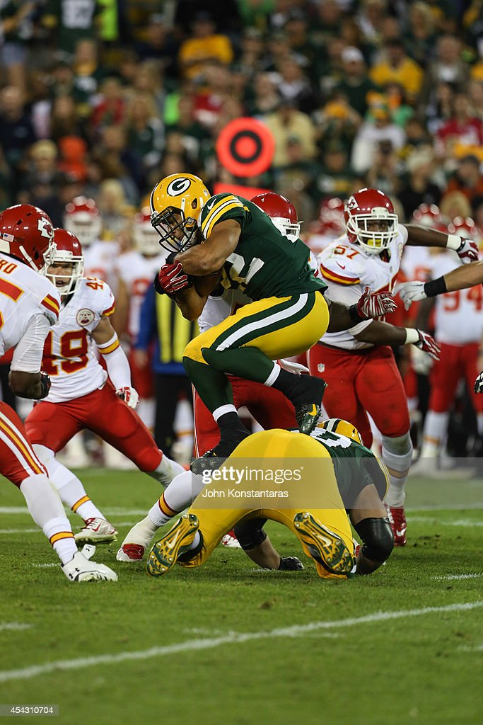Michael Hill #22 of the Green Bay Packers jumps over his teammate in the second half of the preseason game against the Kansas City Chiefs on August 28, 2014 at Lambeau Field in Green Bay, Wisconsin.