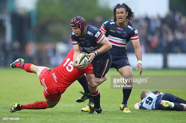 Michael Hills of Doncaster Knights is tackled by Luke Arscott of Bristol Rugby during the Greene King IPA Championship play off final first leg match...