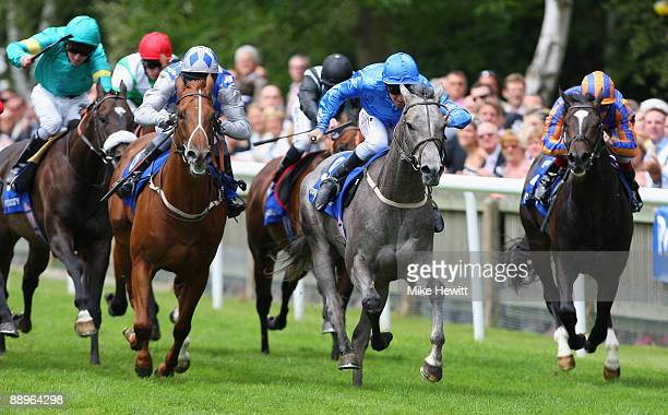 Michael Hills on Silver Grecian wins the Meydan Superlative Stakes at the Newmarket July racecourse on July 10 2009 in Newmarket England