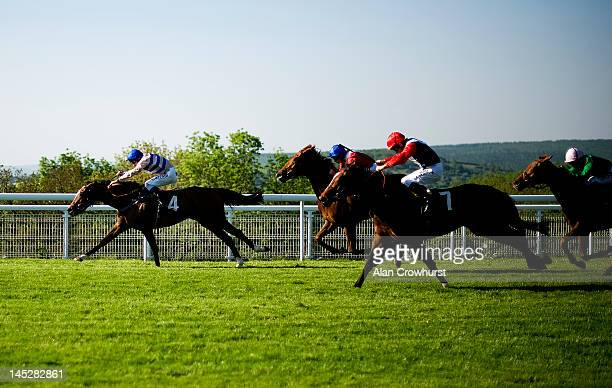 Michael Hills riding Amber Silk win The Golf At Goodwood Fillies' Stakes at Goodwood racecourse on May 25 2012 in Chichester England