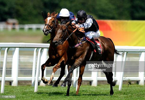 Michael Hills riding Barney Rebel win the Bet On toteplacepot At totesportcom Handicap at Sandown racecourse on June 11 2011 in Esher England