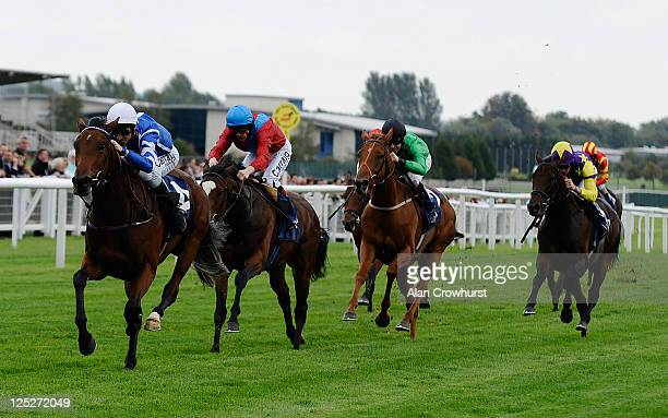 Michael Hills riding Hazel Lavery win the Dubai Duty Free Full Of Surprises EBF 'Pivotal' Fillies' Conditions Stakes at Newbury racecourse on...