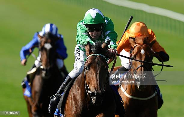 Michael Hills riding Ransom Note win The Nayef Joel Stakes at Newmarket racecourse on September 23 2011 in Newmarket England
