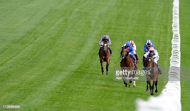 Michael Hills riding Slumber on their way to winning the Investec Derby Trial at Epsom racecourse on April 20 2011 in Epsom England