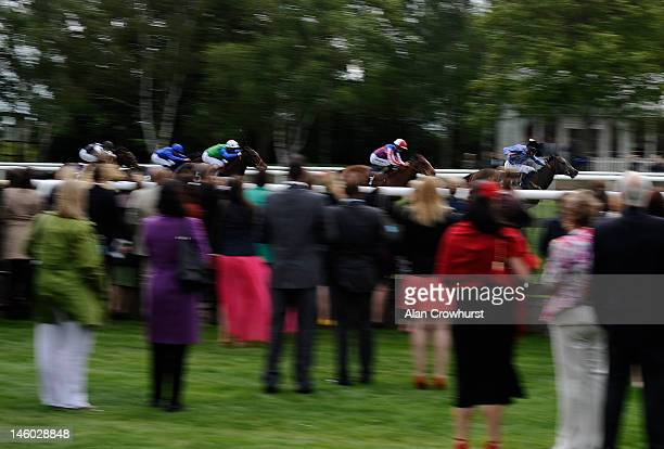 Michael Hills riding Tipping Over win The Fly London Southend To Belfast EBF Maiden Stakes at Newmarket racecourse on June 09 2012 in Newmarket...