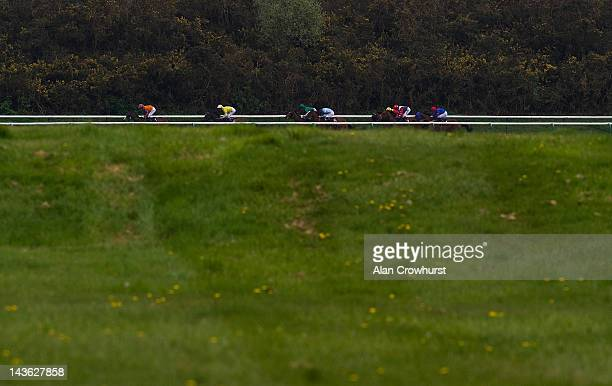 Michael Hills riding Willies Wonder sit in second position before winning The lingfieldparkcouk Handicap Stakes at Lingfield racecourse on May 01...