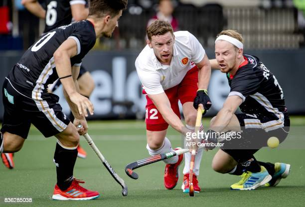 Michael Hoare of England vies with Christopher Ruhr of Germany during the Men's EuroHockey Championships 2017 match between England and Germany in...