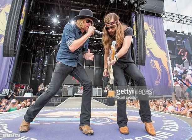 Michael Hobby and Graham Deloach of A Thousand Horses performs during Faster Horses Festival at Michigan International Speedway on July 16 2016 in...