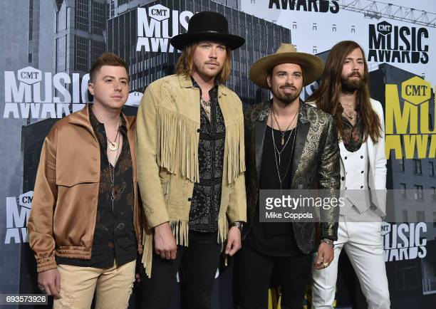 Michael Hobby Bill Satcher Zach Brown and Graham Deloach of A Thousand Horses attend the 2017 CMT Music Awards at the Music City Center on June 7...