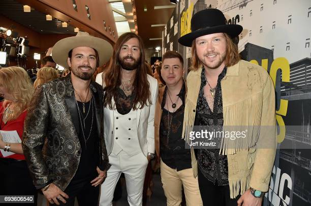 Michael Hobby Bill Satcher Zach Brown and Graham Deloach of A Thousand Horses attends the 2017 CMT Music Awards at the Music City Center on June 7...