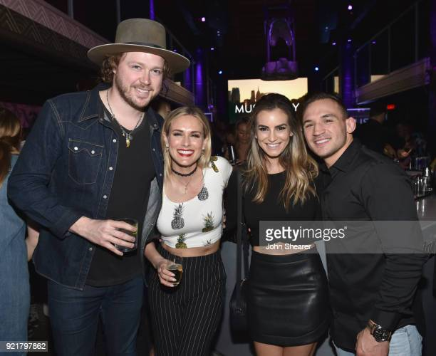 Michael Hobby Caroline Hobby Michael Chandler and Brie Chandler attend CMT's 'Music City' premiere party on February 20 2018 in Nashville Tennessee