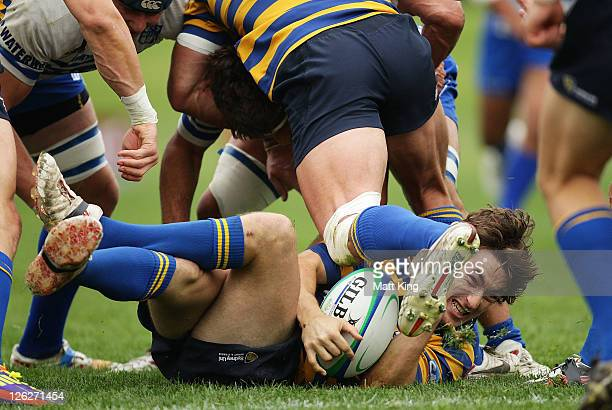 Michael Hodge of Sydney University lies in the ruck during the Shute Shield Grand Final match between Eastwood and Sydney University at Concord Oval...