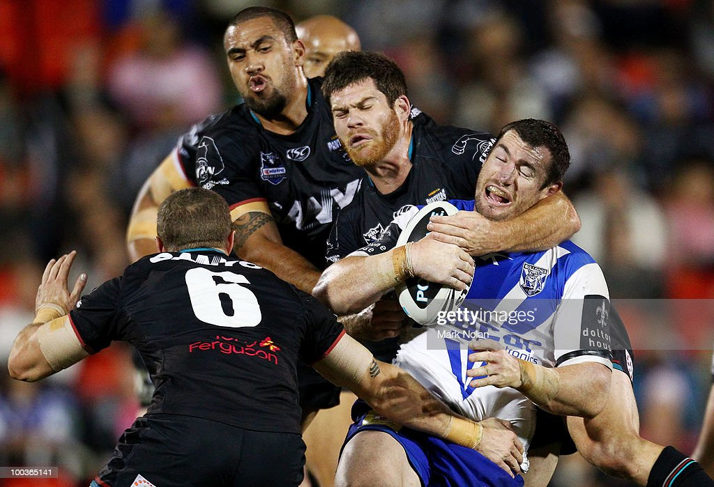 Michael Hodgson of the Bulldogs is tackled during the round 11 NRL match between the Penrith Panthers and the Canterbury Bulldogs at CUA Stadium on May 24, 2010 in Sydney, Australia.