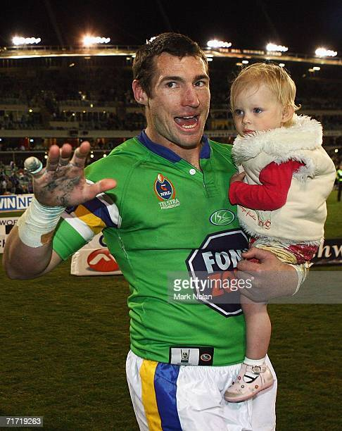 Michael Hodgson of the Raiders farewells the Canberra crowd with his daughter after the round 25 NRL match between the Canberra Raiders and the...