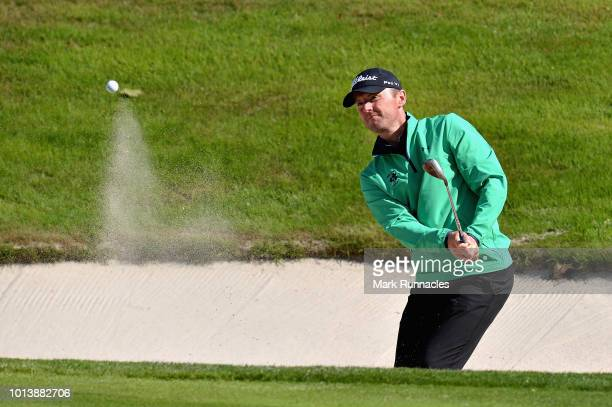 Michael Hoey of Ireland plays from a bunker on hole seventeen during match 4 of Group B during day two of the European Golf Team Championships at...