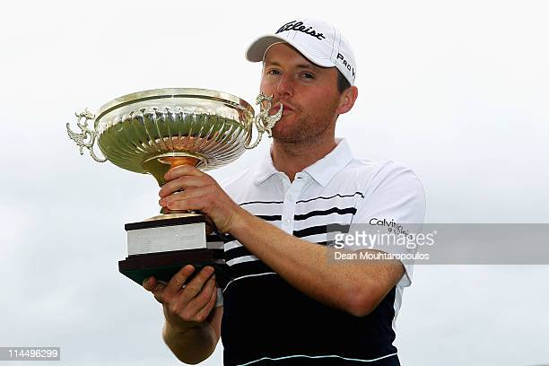 Michael Hoey of Northern Ireland holds the trophy after winning the Madeira Islands Open on May 22 2011 in Porto Santo Island Portugal