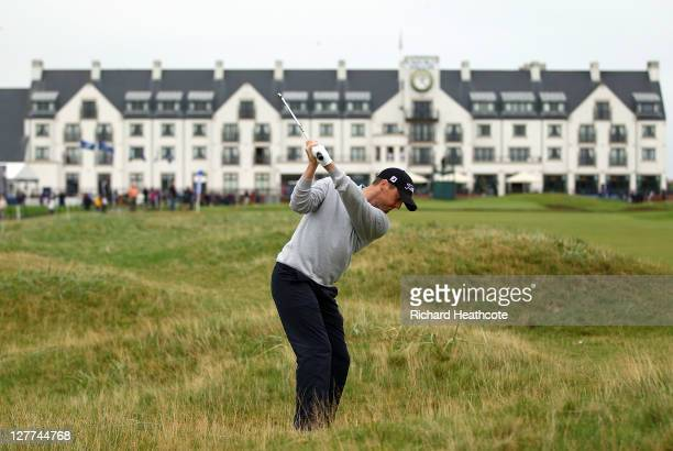 Michael Hoey of Northern Ireland plays his second shot to the 18th green during the third round of The Alfred Dunhill Links Championship at the...