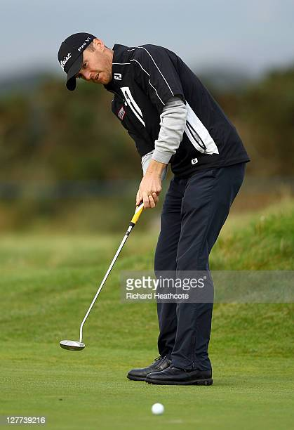 Michael Hoey of Northern Ireland utting for eagle on the 14th green during the third round of The Alfred Dunhill Links Championship at the Carnoustie...