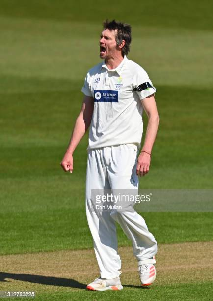 Michael Hogan of Glamorgan celebrates taking the wicket of Aaron Thomason of Sussex during day two of the LV= Insurance County Championship match...