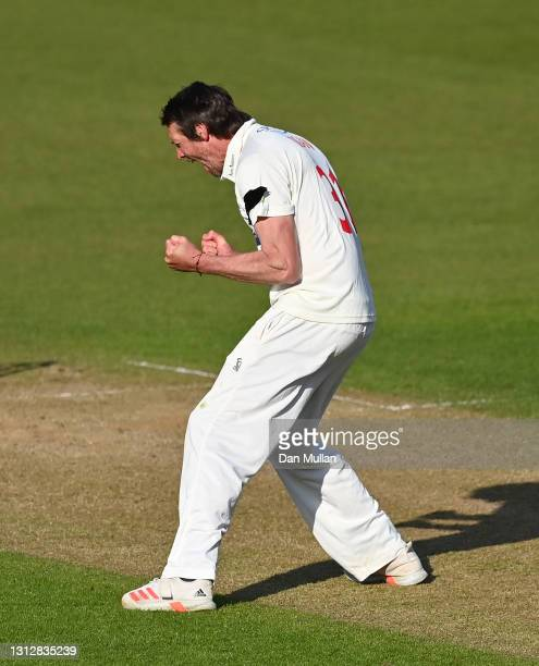 Michael Hogan of Glamorgan celebrates taking the wicket of George Garton of Sussex during day two of the LV= Insurance County Championship match...